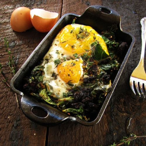 Baked Eggs w/ Sun-Dried Tomatoes and Garlicky Kale