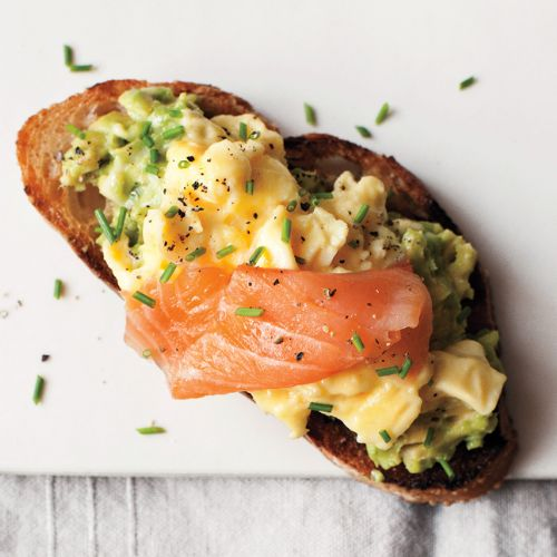 brioche roll with smoked salmon and scrambled egg