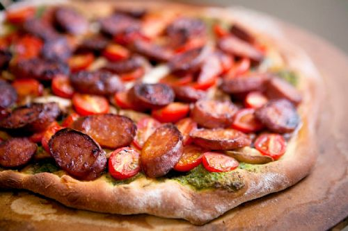 Chorizo, Mushroom, Tomato, and Pesto Pizza