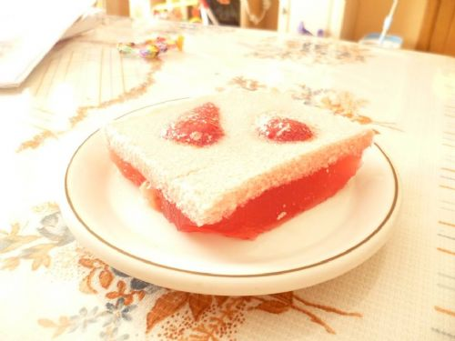 Jelly slice with pieces of strawberries