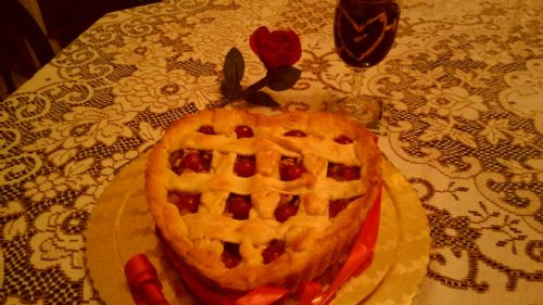 Apple tart with strawberry jam and walnuts