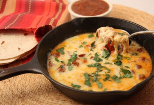 Queso Fundido with Sausage and Peppers